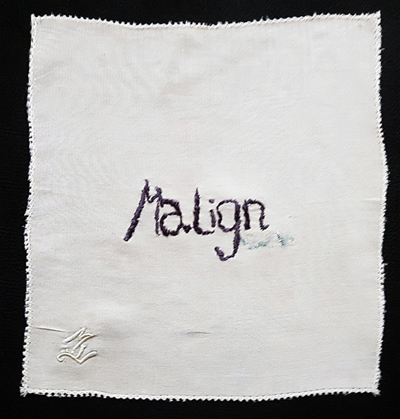 K is for Kevin #6 - MALIGN - embroidery on handkerchief, 15x15cm, Natalie Sirett, 2020